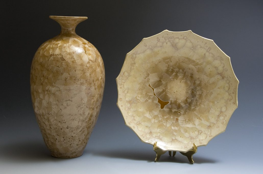 Crystalline glazed vessel and platter on display