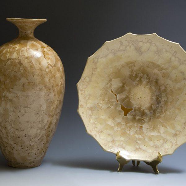 Crystalline glazed vessel and platter on display